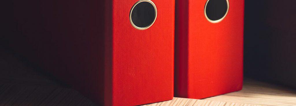 Red file folders on a desk