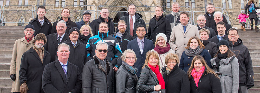 Members and staff of CPMA and CHC in front of Parliament.