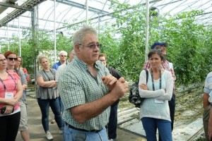 Bob Mitchell, owner of SunTech greenhouses, describes the use of disinfectants to cleanse the greenhouse after the growing season. Photo: D. Folkerson (CHC)