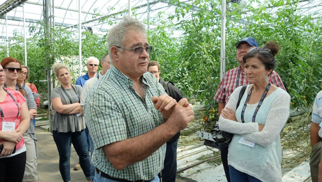 Bob Mitchell, owner of SunTech greenhouses, describes the use of disinfectants to cleanse the greenhouse after the growing season, during the CHC crop protection information tour.