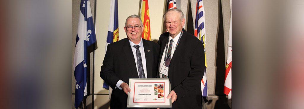 alvin presenting the doug connory award to john macdonald