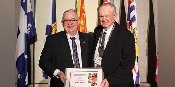 John MacDonald receiving Doug Connery award